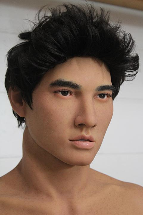 The thumbnail depicts an incredibly lifelike and good looking male sex doll.